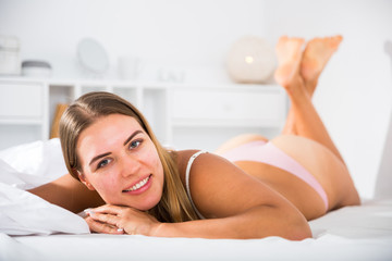 Poster Akt Woman in lingerie lying in bed
