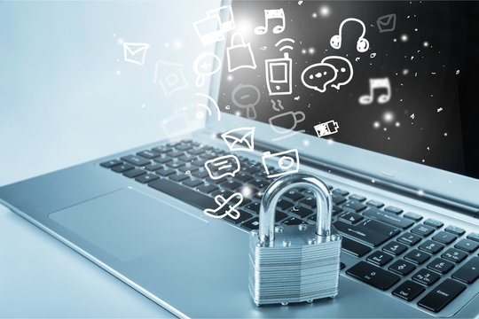 Lock on the laptop  background,Cyber safety concept