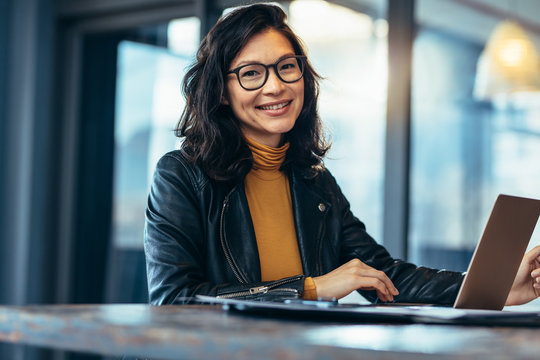 Smiling business woman in casuals at office