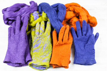 various handmade felted gloves and wools for them