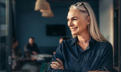 Female entrepreneur standing in office