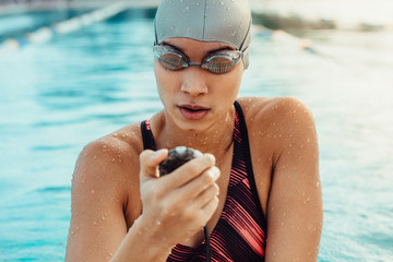 Female swimmer preparing for competition