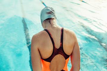 Woman in swimwear practising in pool