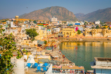 Panoramic view on Holy Lake and city Pushkar, Rajasthan, India. Wall mural