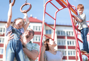young family with children playing in the Playground