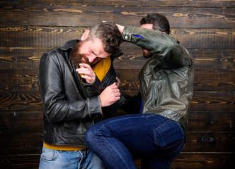 Street fight concept. Men brutal hooligans wear leather jackets fighting. Physical attack. Men bearded hipster fighting. Attack and defence. Aggressive hooligan fighting with strong bully man
