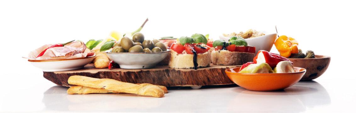 Italian antipasti wine snacks set. Cheese variety, Mediterranean olives, pickles, Prosciutto di Parma, tomatoes, artichokes