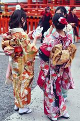 Women in kimono standing outdoors