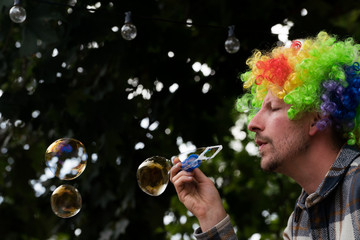 Man blowing bubbles outdoors