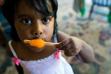 Close up of girl eating popsicle