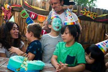 Family celebrating birthday outdoors