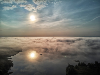 Sunset and fog on the Volga River near the city of Ulyanovsk. Russia. View of the city.