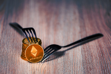 Stack of Ethereum cryptocurrency hard fork concept
