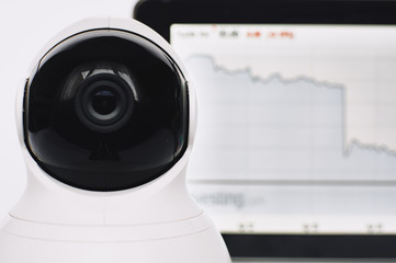 CCTV Camera security operating or security camera monitoring in office building. Security camera and tablet with graphs, charts, tables