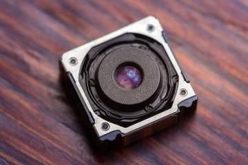 Close up of a mobile phone stabilized camera sensor.