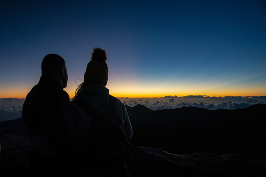 silhouette of couple at sunrise