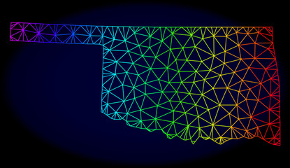 Rainbow colored mesh vector map of Oklahoma State isolated on a dark blue background. Abstract lines, triangles forms map of Oklahoma State. Carcass model for patriotic purposes.
