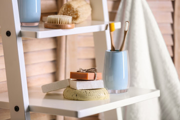 Wall Mural - Soap and toiletries on wooden shelves in bathroom
