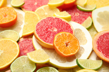 Slices of different citrus fruits as background