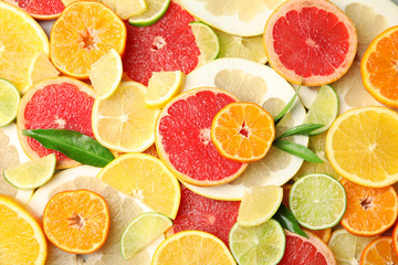 Different citrus fruits as background, top view