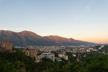 Skyline of Caracas city and Avila mountain, at sunset, in Venezuela