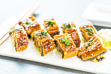 Fototapeta Grilled eel or unagi fish sushi maki roll with sweet sauce obraz