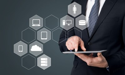 Businessman and tablet pc  with abstract business icon sketches