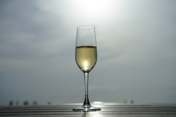 champagne glass with blurred sea and sky background
