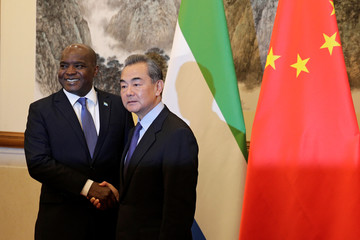 Sierra Leone's Foreign Minister Alie Kabba, left, and Chinese Foreign Minister Wang Yi pose for photographers before proceeding to their meeting at the Diaoyutai State Guesthouse in Beijing