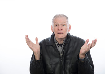 Older man shrugging shoulders with questioning, frustrated expression