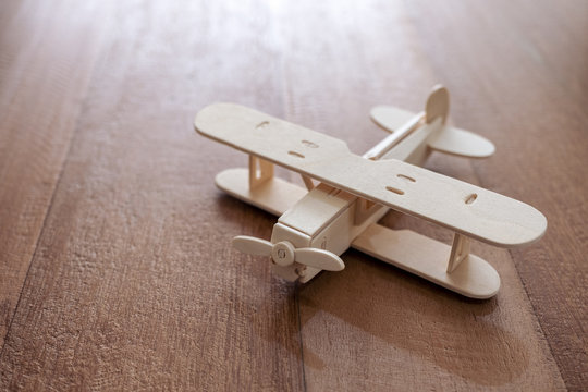 Closeup image of a wooden airplane on the table