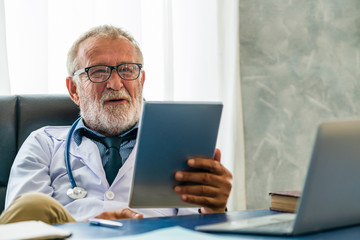 Doctor working in hospital office. Medical healthcare concept.
