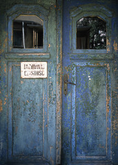 """old door with text in polish language """" keep it clean"""", Lodz, Poland"""