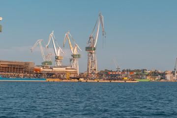 rusty cranes in port of pula, croatia