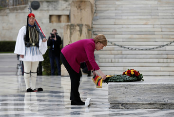 German Chancellor Angela Merkel attends a wreath-laying ceremony on the Tomb of the Unknown Soldier