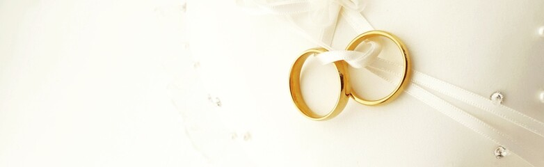 Wedding banner with rings on pillow