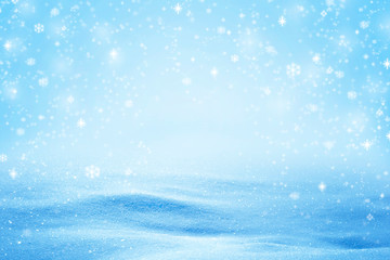 Natural sunny snow drifts background with shades and falling snow flakes.