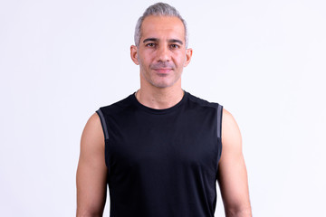 Handsome Persian man ready for gym against white background