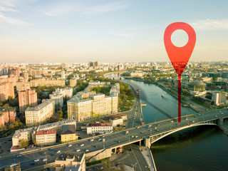 aerial shot of marker pointing on the streets of europe city during sunset b
