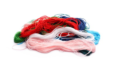 Colorful string for sewing and knitting, isolated on white background