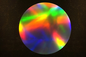 Circle metallic rainbow made of foil on dark background