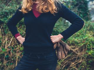 Woman with gardening gloves in the garden