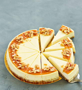 Cheesecake with caramel and peanuts. Slice.
