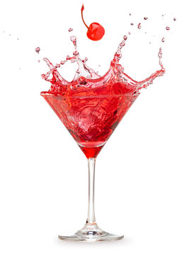 cherry falling into a splashing red cocktail isolated on white