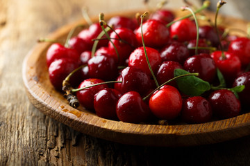 Fresh cherry on wooden desk