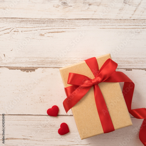 Kraft Gift Box With Red Ribbon Bow Concept Of Giving Present And