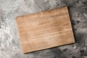Wooden kitchen board on grey background