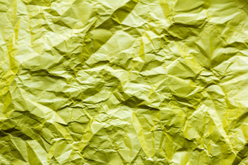 background, texture of crumpled yellow paper