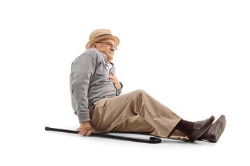 Elderly man on the floor heaving a chest pain