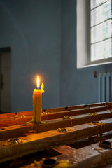 Burning candle at Koknese Evangelical Lutheran Church.